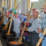 It takes a lot of muscle to create 2500 gallons of Brunswick Stew!